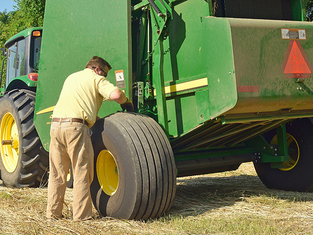The owner's manual doesn't always have the answers. Sometimes, it's just plain old good experience that fixes a baler problem. (DTN/Progressive Farmer photo by Jim Patrico)